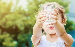 Child with water glass